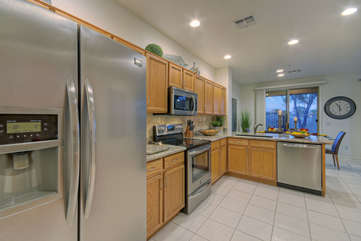 Modern, completely stocked kitchen has wonderful outdoor views that may distract the chef