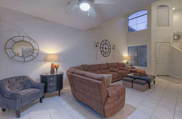 Vaulted ceilings, tile floor and contemporary furnishings create a great room that is nothing short of GREAT!
