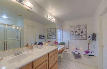 Ensuite master bath features garden tub, walk in shower and make-up vanity
