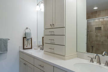 The master bath has a double vanity and large shower.